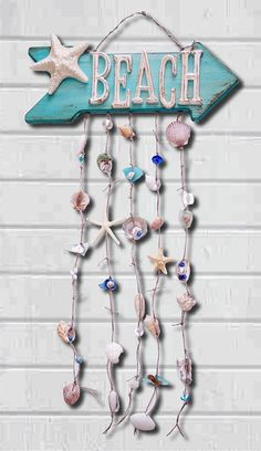Beach Shell Windchime was hand painted with a distressed finish and is loaded full of texture and color! This wood arrow sign has been hand