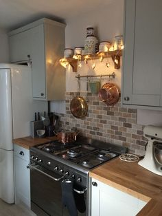 My new kitchen - Howden's Burford Grey with Smeg oven. The tiles are perfect. Country Kitchen, New Kitchen, Kitchen Dining, Kitchen Decor, Brown Kitchen Tiles, Stools For Kitchen Island, Kitchen Utensils, Paint For Kitchen Walls, Kitchen Pantry Storage