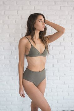 Khaki high waist bikini bottoms with moderate coverage and a super comfortable seamless fit. Made and manufactured in the USA at the highest quality standards.