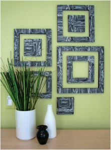 Paint over old wall art. Recycling canvases reduces your waste and can also create really cool textures!