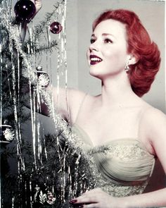 Piper Laurie trims the tree, 1950s