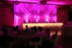 Head table with draping behind..same as earlier pinned but look how much lighting changes things