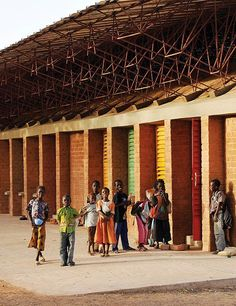 Architect Diébédo Francis Kéré, eager to bring education to his own country, helped build this elementary school in Burkina Faso, one of the poorest nations in Africa. Education Architecture, Green Architecture, Concept Architecture, School Architecture, Sustainable Architecture, Sustainable Design, Amazing Architecture, Architecture Details, Building Facade