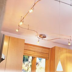 """I love this lighting idea. I am not sure I would do it in my kitchen or in the basement where it needs more light, """"Low voltage track lighting system"""""""