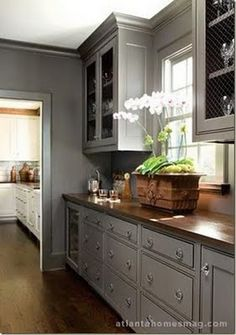 Love the gray with the dark wood.. Would pair it with off white cabinets