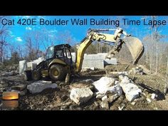 Caterpillar 420e Backhoe Moving A Heavy Rock Slab And