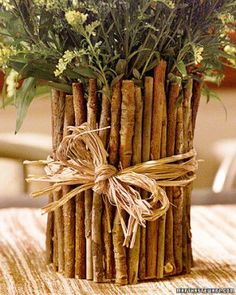use old coffee can - Couldn't you use any size can/sticks you want? Would make a cute arrangement doing different sizes.