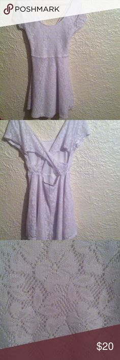$15 SALE 🎉Wet Seal White Lace Dress Cross back Excellent condition!  Very Cute and Sexy!! No trades!  Pit to pit is 16 inches. Length is 32 inches. Wet Seal Dresses Mini