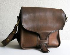 I love vintage Coach bags!  Don't care much for current Coach though.
