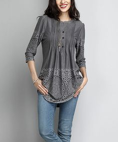 A subtle pattern enlivens this comfy tunic cut with a face-framing notch neck design. With lightweight, stretch-kissed fabric, this tunic is a comfy wardrobe must-have.Made for zulilyModel: 5' 8'' tall; 33'' bust; 24'' waist; 35'' hipsSize S: 33'' long from high point of shoulder to hemKnit96% rayon / 4% spandexMachine washImportedShipping note: This item is made to order. Allow extra time for your special find to ship.