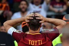 Roma's forward from Italy Francesco Totti reacts during a ceremony to celebrate his last match with AS Roma after the Italian Serie A football match AS Roma vs Genoa on May 28, 2017 at the Olympic Stadium in Rome. Italian football icon Francesco Totti retired from Serie A after 25 seasons with Roma, in the process joining a select group of 'one-club' players. / AFP PHOTO / Vincenzo PINTO