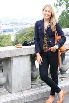 black or navy pants and blazer with printed top and neutral accessories