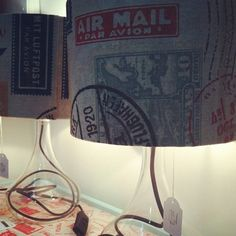 Travel print lampshades with glass base.