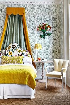 WALL Wallpaper, 'Les Touches' (green), by Brunschwig & Fils, £140 for a 5-metre roll, from G P & J Baker. Bed curtain, 'Fermoie Plain' (L-187), cotton, £96 a metre; lined with 'Rabanna' (L-265), cotton, £96 a metre; both from Fermoie. Glazed porcelain wall-mounted vase, 'Hain', 50 x 40 x 19cm, £2,500, from The Conran Shop. Artificial tulips, from £1.99 each, from Decoflora.