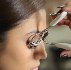 Straightening curly eyelashes helps keep them from getting in the way.