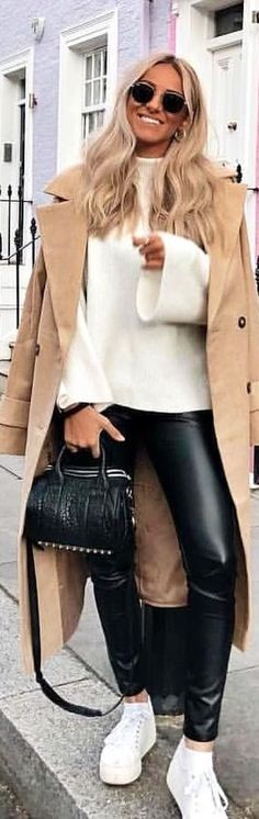#spring #outfits woman in white shirt holding leather bag. Pic by @prettylittleiiinspo