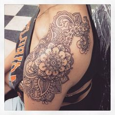Attractive Paisley Flower Pattern Tattoo On Upper Shoulder