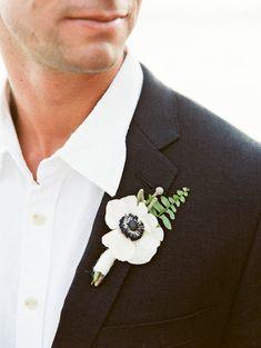 anemone wedding boutonniere is so simple yet elegant  http://www.weddingchicks.com #groomideas/2013/12/09/glacier-national-park-wedding/