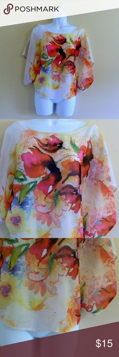 "(301) Watercolor Floral Sheer Shawl Blouse -Size L I love the colorful eye catching print on this sheer shawl blouse. Beautiful watercolor floral in bright shades. Loose, flowy sleeves. Bust: 40"", waist: 40"", length: 21.5"", label: BodyC, size: large, materials: polyester. Body Central Tops Blouses"