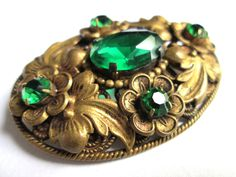 Vintage Filigree Floral Brooch Pin Gold Brass Tone Emerald Green Claw Set Rhinestones Oval C Catch Czech Style by eKatJewels on Etsy