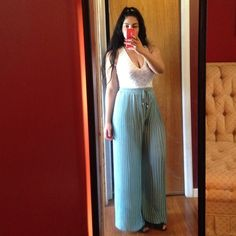 """Mint pleated pants.💥 Solid pleated chiffon palazzo pants with elastic waist band. One size but stretches a lot so can fit (S-XL). Measurement while laying flat.     Waist: 13"""" length: 41.5""""... Lined with shorts. Dress it up or down. Belt is not included Pants Wide Leg"""