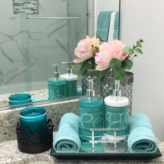 The teal decoration would help make the bathroom more welcome and it is a unique…