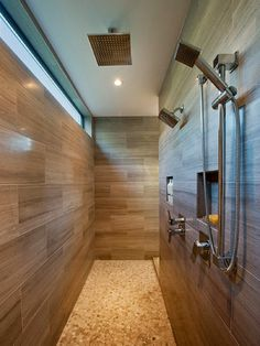 The walk in double shower. The window along the top of the wall to let light in but maintain privacy.