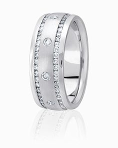 Diamond Cut Grooves Are Channel Set With Round Brilliant Diamonds In This Wedding Band With Stone Finish