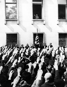 Berlin men gather to greet the Chancellor of Germany, Adolf Hitler.
