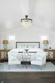 This home's designer, Becky Owens, made a cozy nook at the foot of the bed with two tufted chairs. Don't have the space? Tuck in an upholstered bench or pouf.