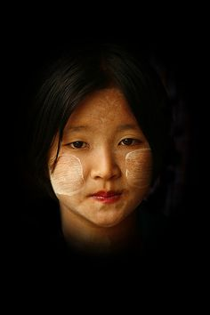 Girl with thanaka make up on the cheeks, Myanmar by Eric Lafforgue, via Flickr