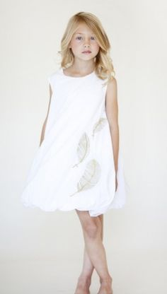 white cotton dress with gold coloured embroidery of feathers