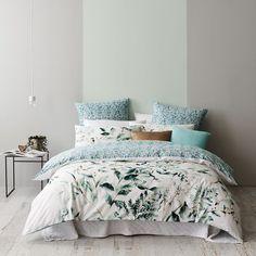 Anita's bedroom need throw rug and two beige European cushions