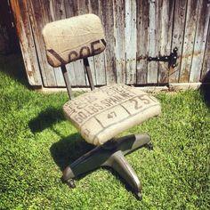 Vintage metal office chair reupholstered in burlap coffee sacks.