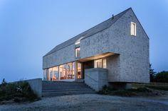 MacKay-Lyons Sweetapple elevates cedar-clad cabin in Nova Scotia on concrete plinths