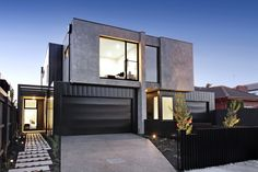 High end quality finishes make this Melbourne Townhouse a stand out. A very contemporary facade with polished concrete rendered facade and black Colorbond metal wall cladding. Designed by Sketch Building Design.