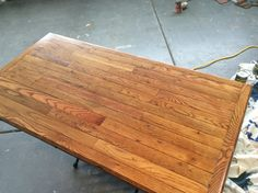 The distressed marks really show thru now, this table has character.