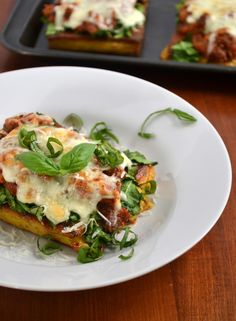 Creamy Herbed Polenta Recipe - baked and top with your favorite Italian sauce, spinach, cheese and basil - then bake again, to make Polenta Lasagna