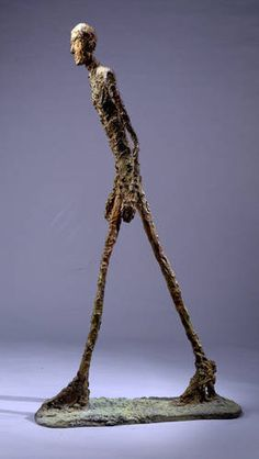 Walking Man by Giacometti. this was on the cover of a book i tried to read about existentialists when i was in high school.
