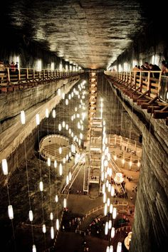 (Underground Architecture - Turda Salt Mine) Salina Turda (Salt Mine), Cluj County, Transylvania, Romania Rudolf Mine - 80 m long, 50 m wide, up to 917 m deep (touristic Underground Gallery) View of the Underground Cinema Theater, soccer field, amusement park, restaurant etc.
