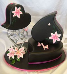 Stylized black cake set with pink detail.