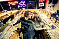 engagement photo in record store