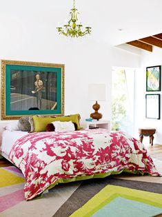 Something about this room just makes me smile. Is it the white walls, the vibrant bedding, the fun rug?