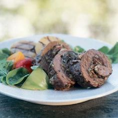 Stuffed Flank Steak Recipe Main Dishes with bread crumbs, romano cheese, salami, toasted pine nuts, large garlic cloves, anchovy fillets, flat leaf parsley, fresh oregano, flank steak, freshly ground pepper, olive oil