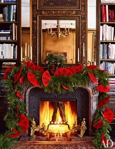Ultimate Holiday Style - Design Chic - what an amazing garland with red fans from Bronson van Wyck