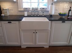 Jet Mist granite countertops in the honed finish.   Kitchen Intuitions