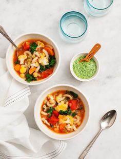 Chickpea and Cauliflower Tomato Stew - A hearty & healthy vegetable minestrone stew topped with kale pesto. Perfect for cold winter nights, PLUS, the leftovers reheat great for lunch. Vegan and gluten free.