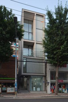 JMY Architects Combines Living And Retail Spaces On A Narrow Site In Busan - http://decor10blog.com/decorating-ideas/jmy-architects-combines-living-and-retail-spaces-on-a-narrow-site-in-busan.html