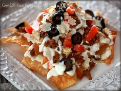 What are Italian Nachos?   Crispy pasta chips with ground Italian Sausage and or sliced grilled chicken, pepperoncini peppers, black olives, Roma's tomatoes and jalapenos.  Topped with creamy Alfredo sauce, melted mozzarella and Parmesan cheese.