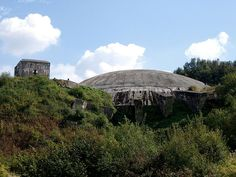 La Coupole (English: The Dome)-Bauvorhaben 21 (Building Project 21)Constructed in the side of a disused chalk quarry, the most prominent feature of the complex is an immense concrete dome, to which its modern name refers. It was built above a network of tunnels housing storage areas, launch facilities and crew quarters. The facility was designed to store a large stockpile of V-2s, warheads and fuel and was intended to launch V-2s on an industrial scale.